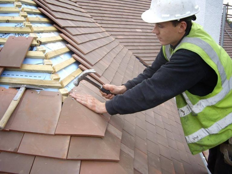 roofer in dundee repairing tiled roof